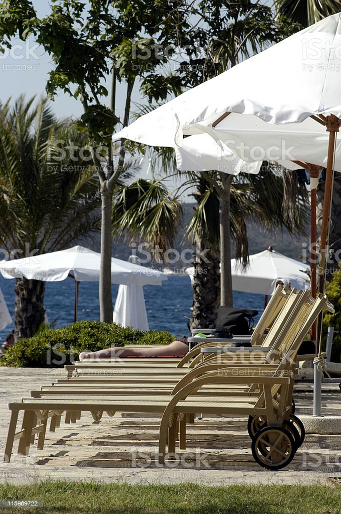 Lounge chairs in a row stock photo