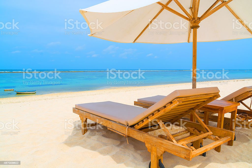 Lounge chairs on a tropical beach stock photo