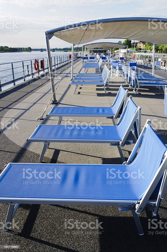 Lounge chairs on cruise boat deck stock photo