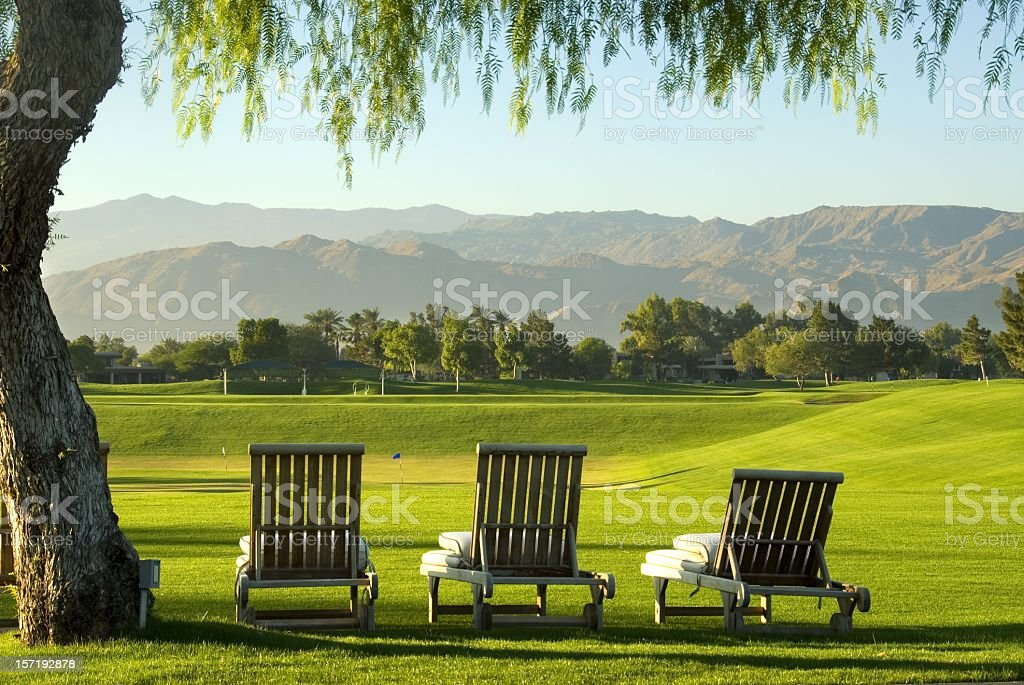 Lounge chairs overlooking a golf course stock photo