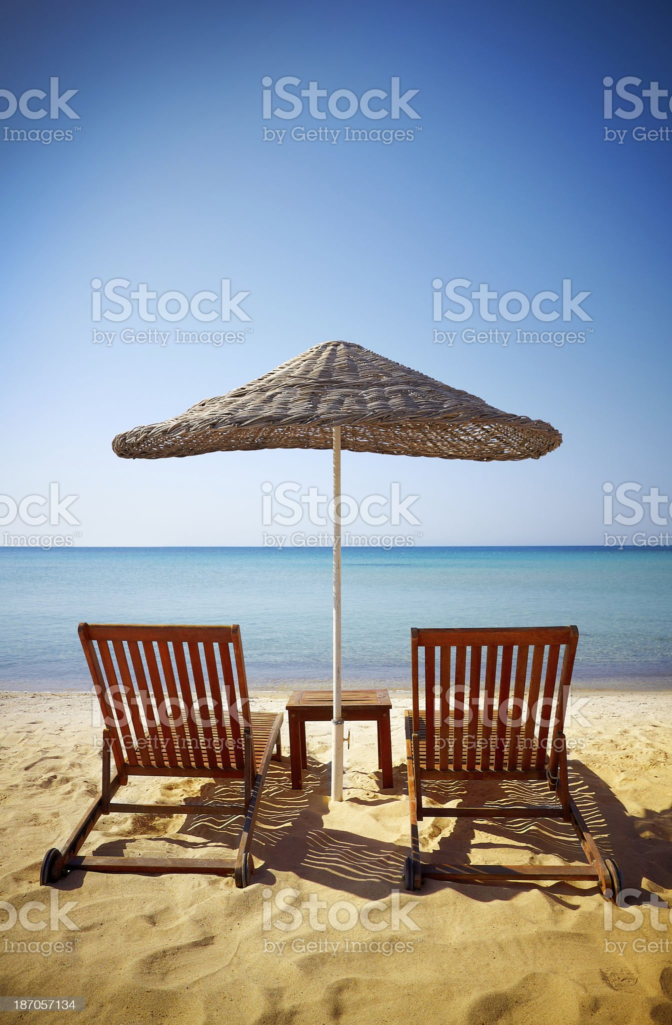 Lounge Chairs with parasol royalty-free stock photo