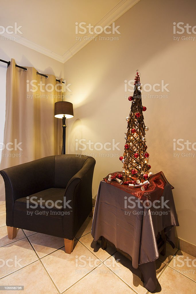 Lounge interior with chair and Xmas tree royalty-free stock photo