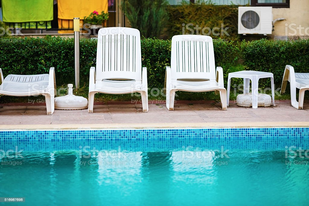 Loungers by the pool stock photo