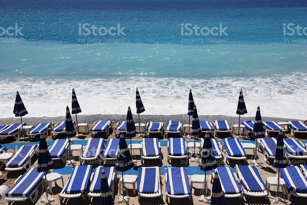 loungers on the beach stock photo