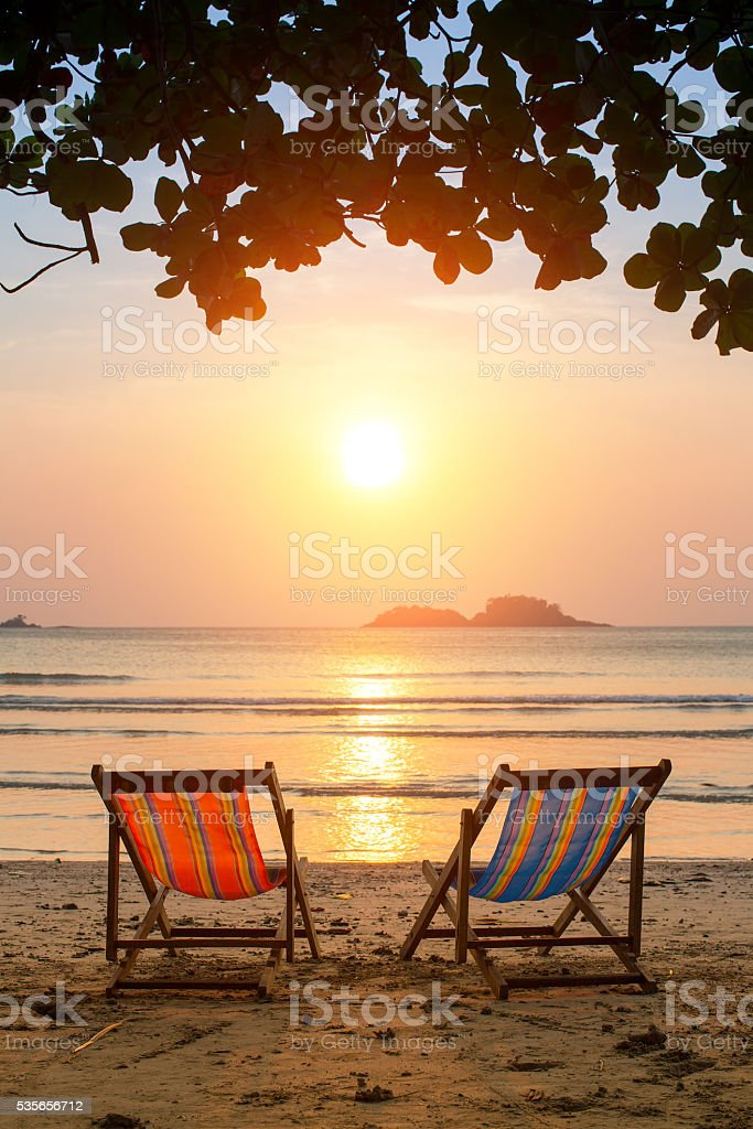 Loungers on the Sea beach at amazing sunrise. stock photo