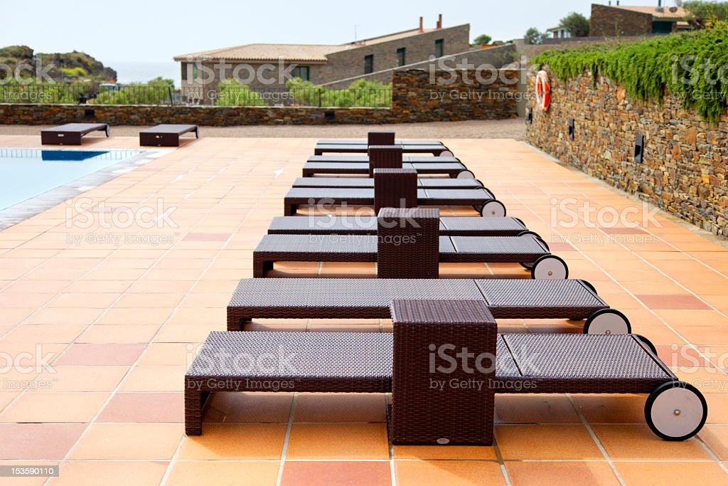 Loungers poolside royalty-free stock photo