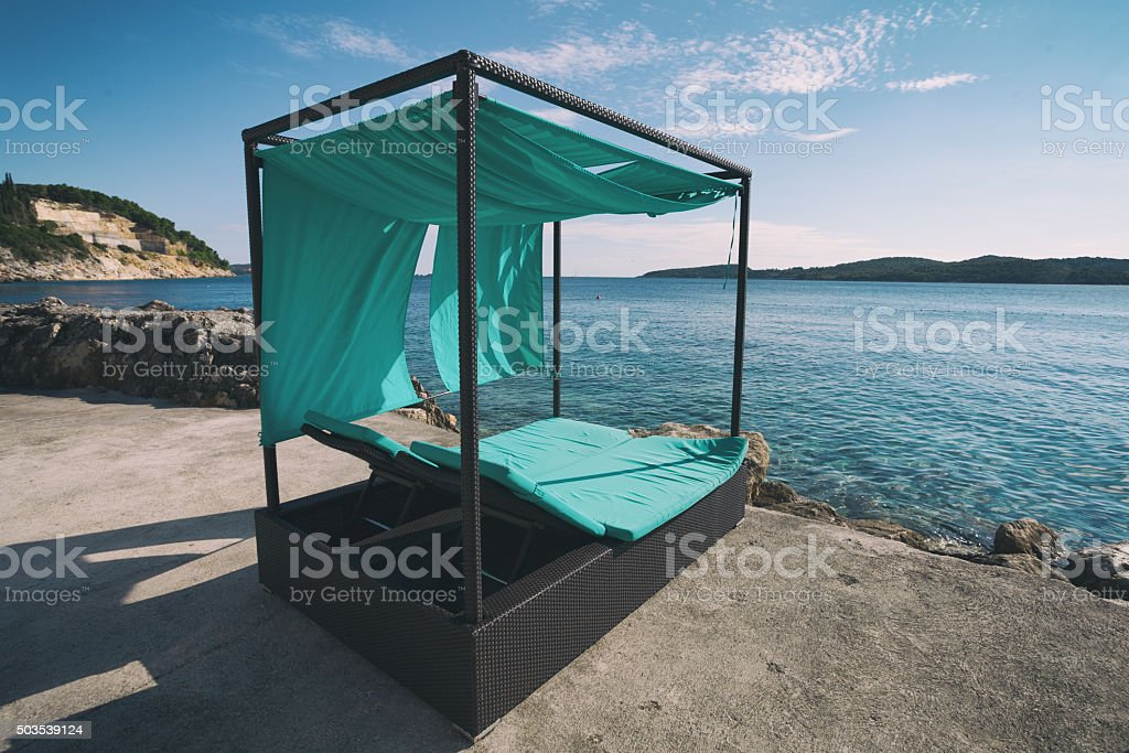 loungers with baldachin stock photo
