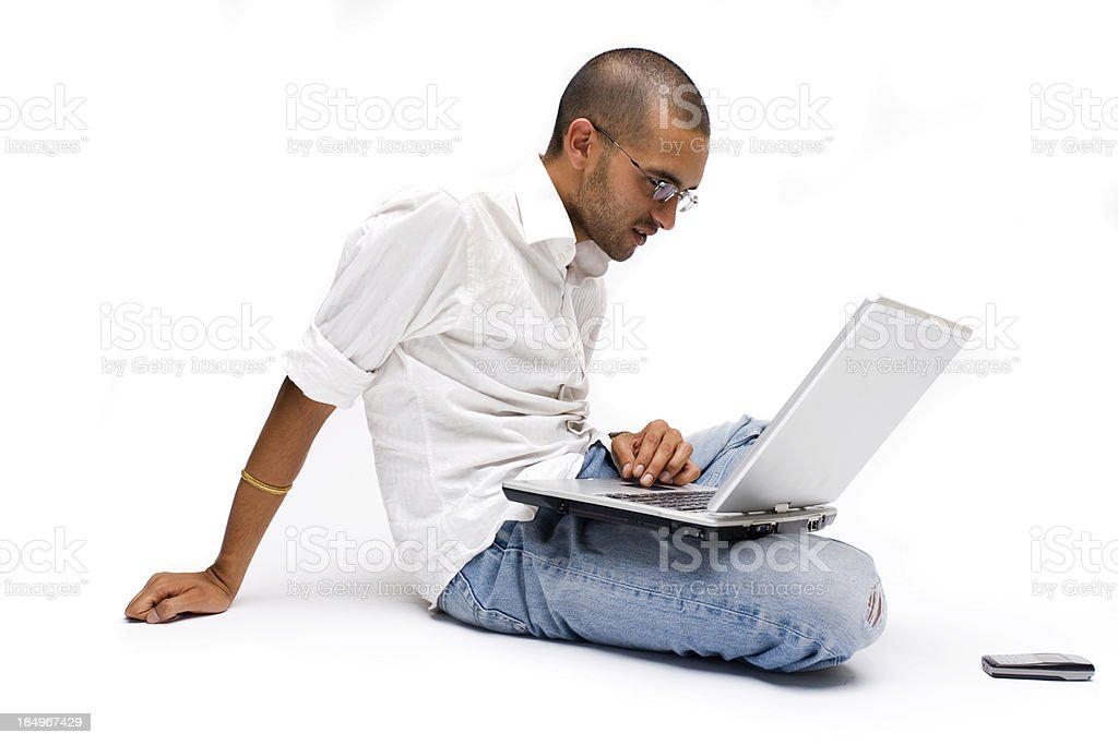 Lounging with a laptop stock photo