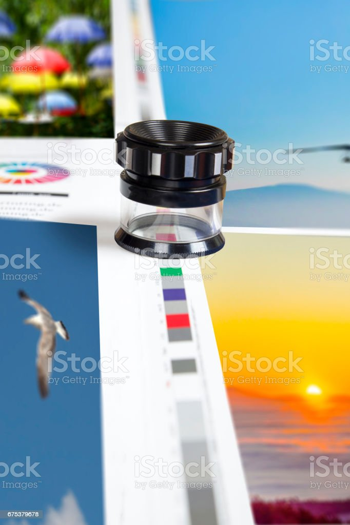 Loupe on offset print sheet color controll bar stock photo