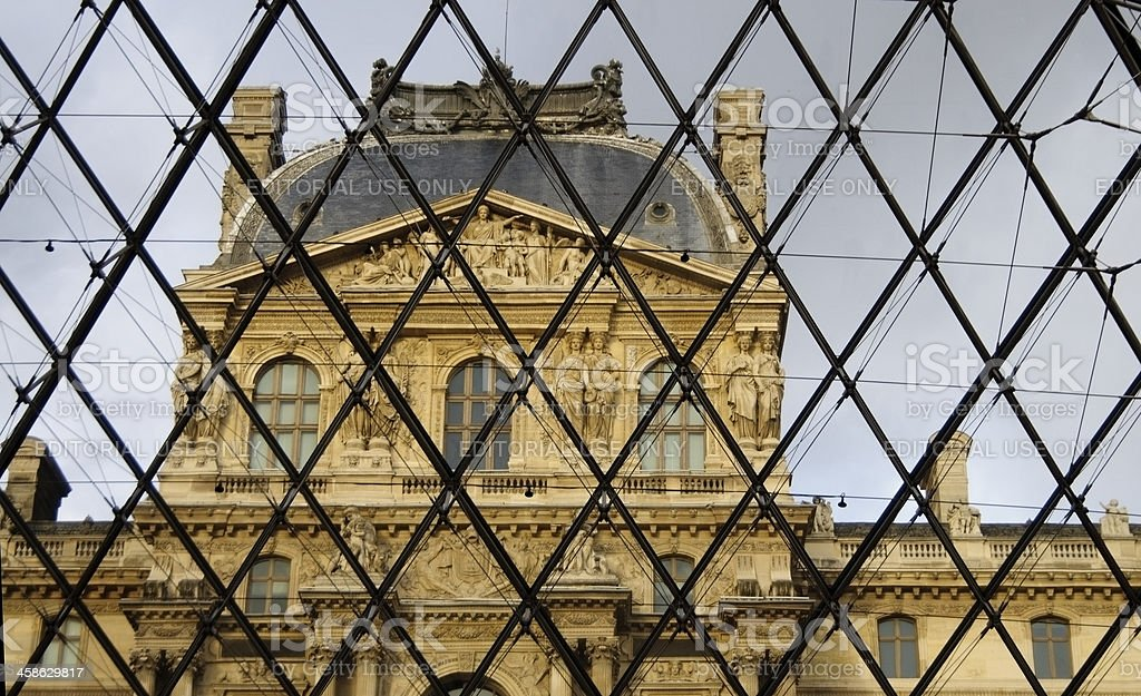 Louvre Museum building through window stock photo