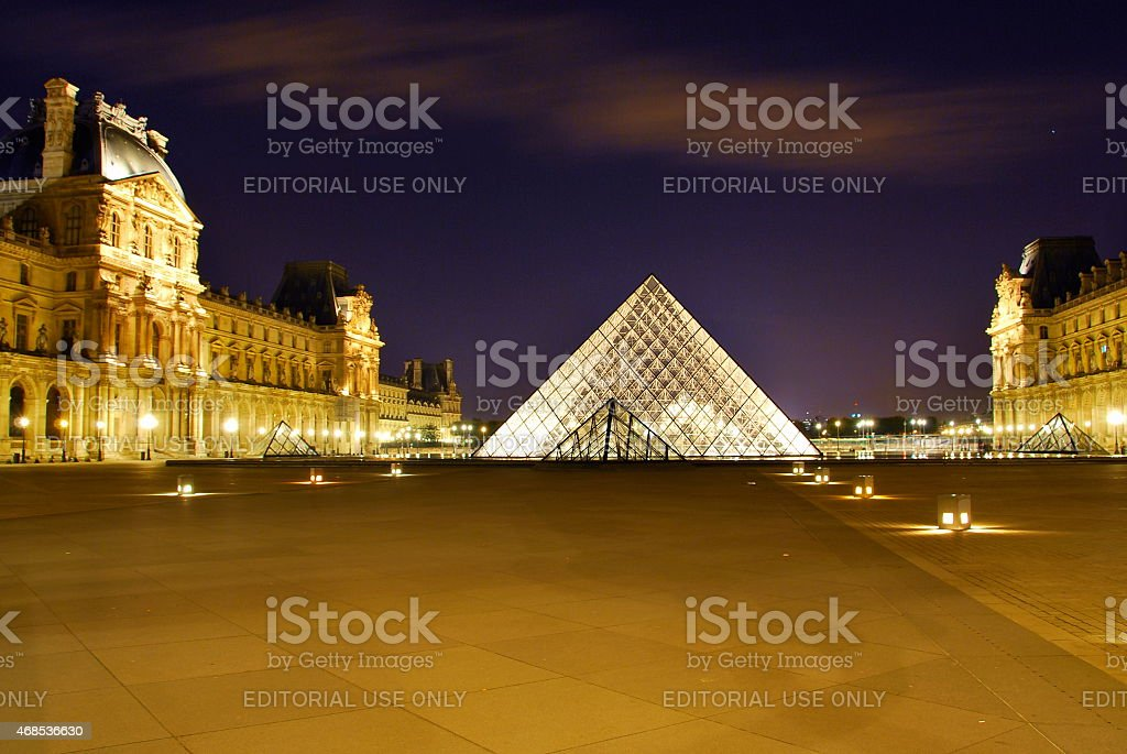 Louvre Pyramid and the palace, at night stock photo
