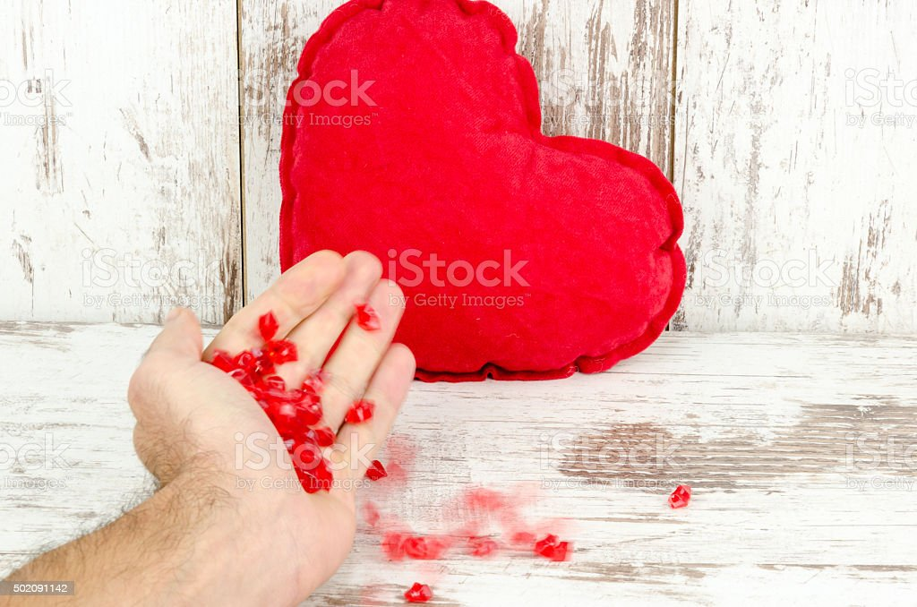 Love and heart on a wooden background stock photo