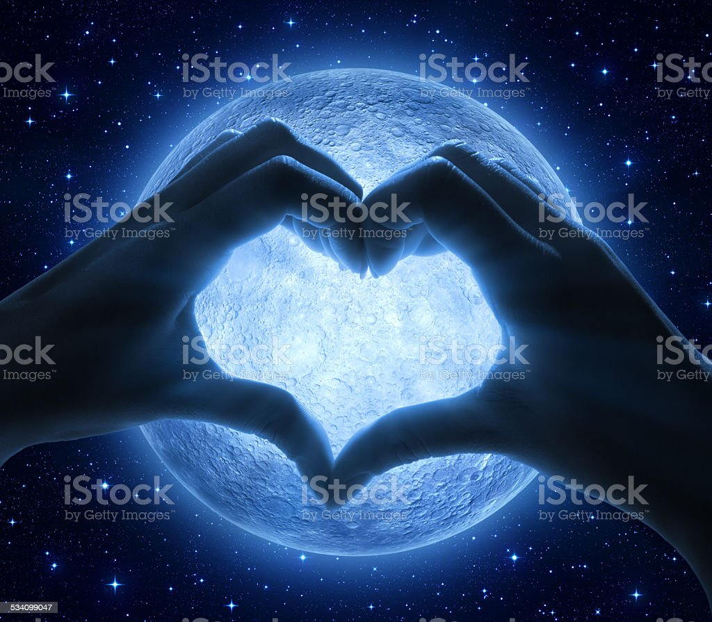 love and moon - romantic sign with hands stock photo