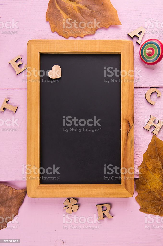Love and small black board in the pink background. stock photo