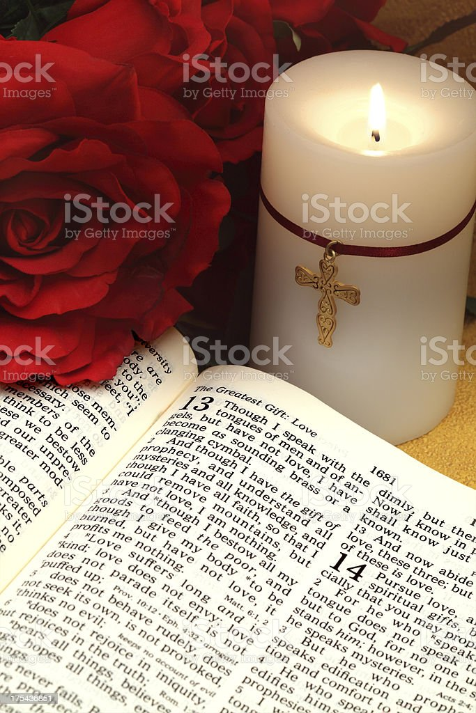 Love Bible Scripture with Candle and Roses stock photo