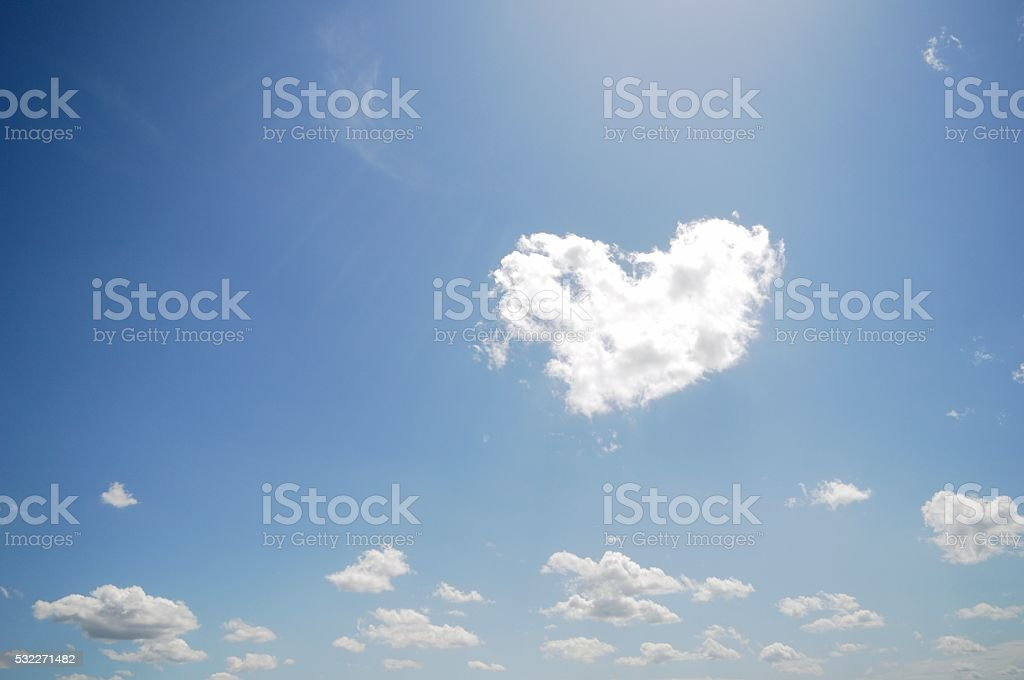 Love Cloud With Heart Shape And Small Other Clouds stock photo