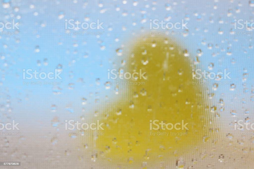 Love concept - autumn rain, the heart in glass stock photo