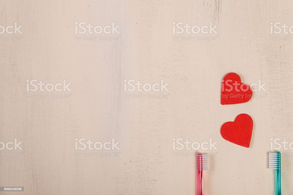 Love concept with hearts and toothbrushes. stock photo