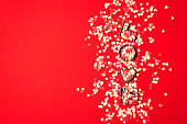 Love concept with letters LOVE and sweethearts on a red