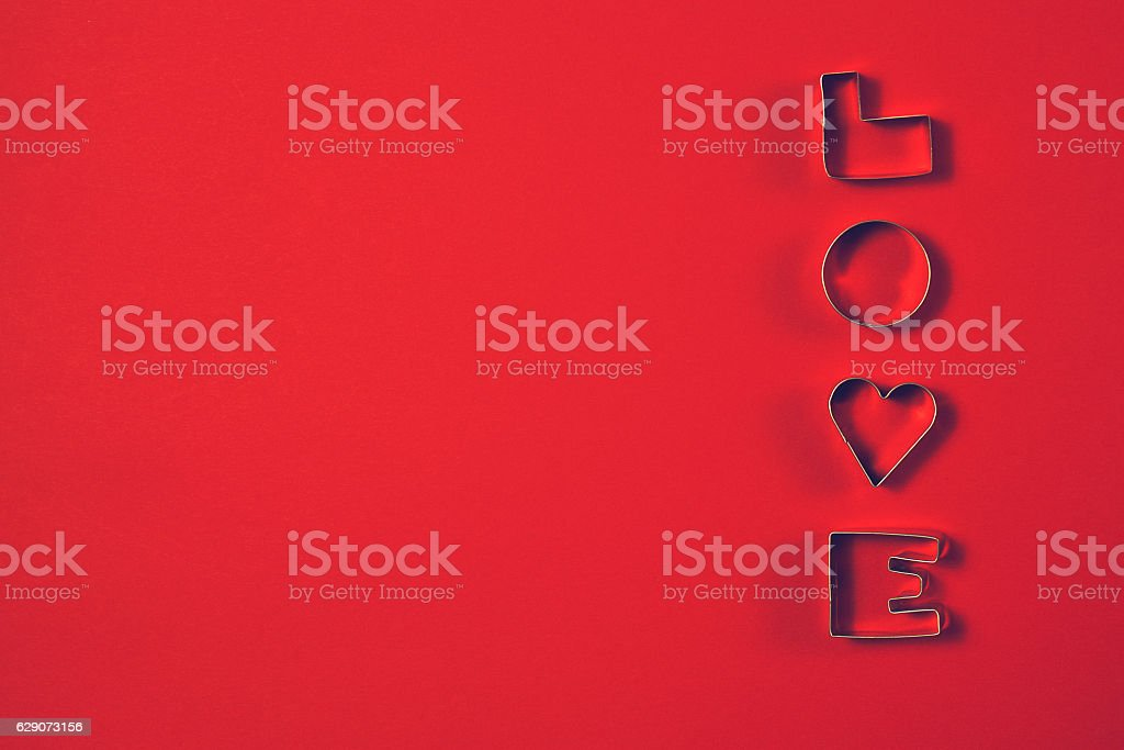 Love concept with letters LOVE on a red background. stock photo