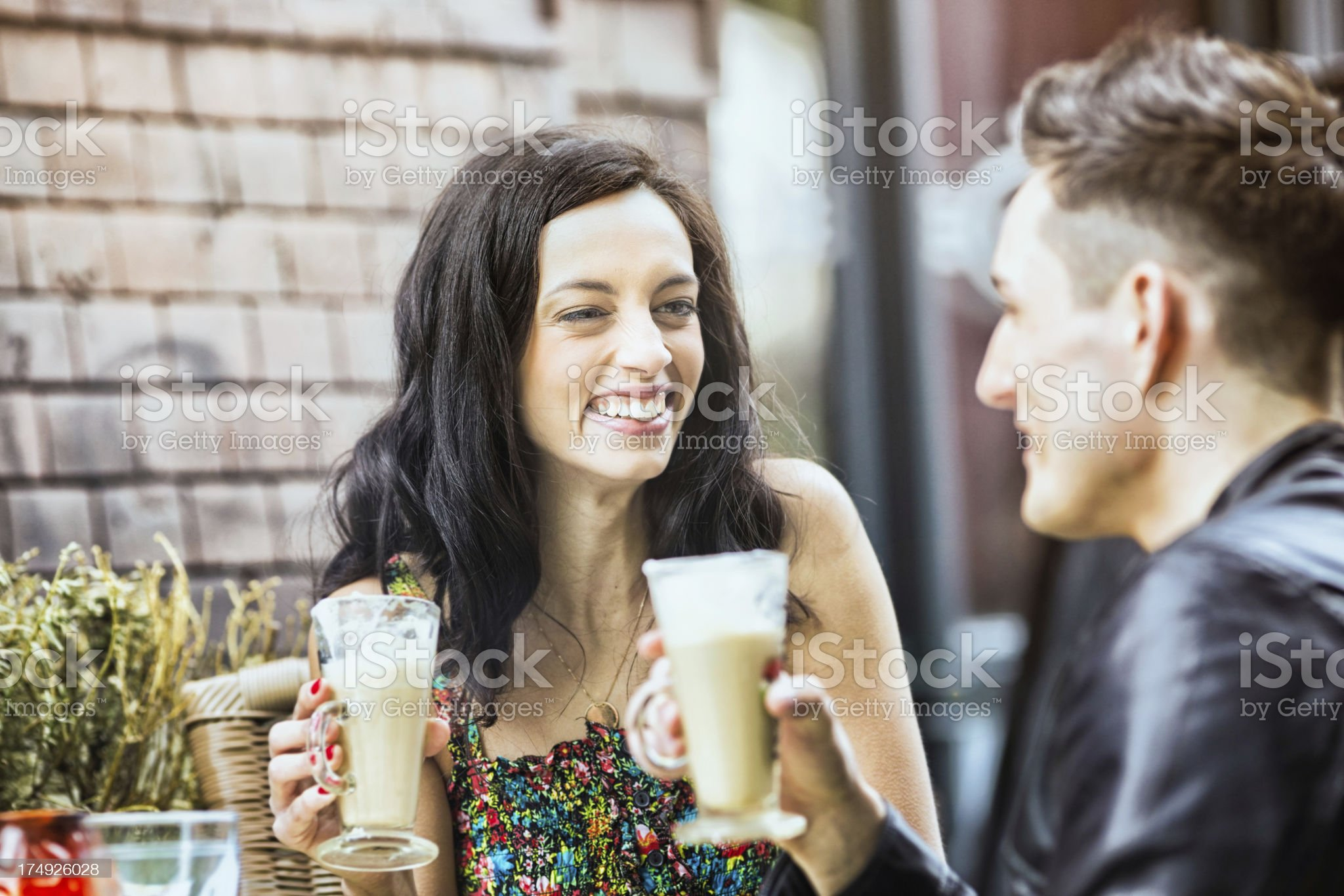 Love connection over Lattes in Berlin Cafe royalty-free stock photo