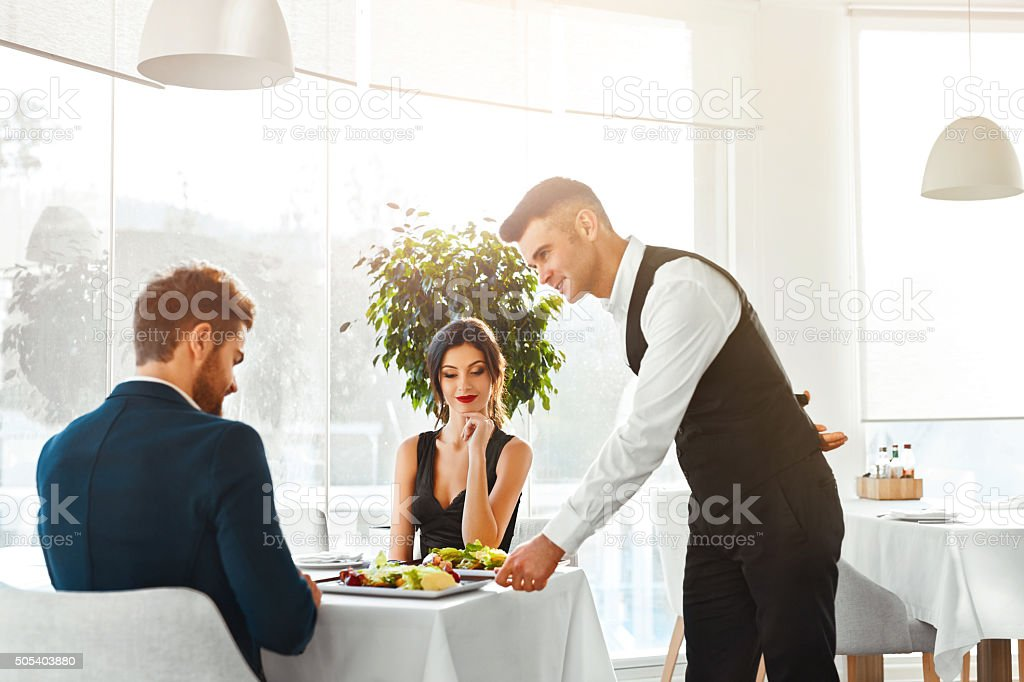 Love Couple Having Romantic Dinner In Restaurant. Healthy Food Eating. stock photo