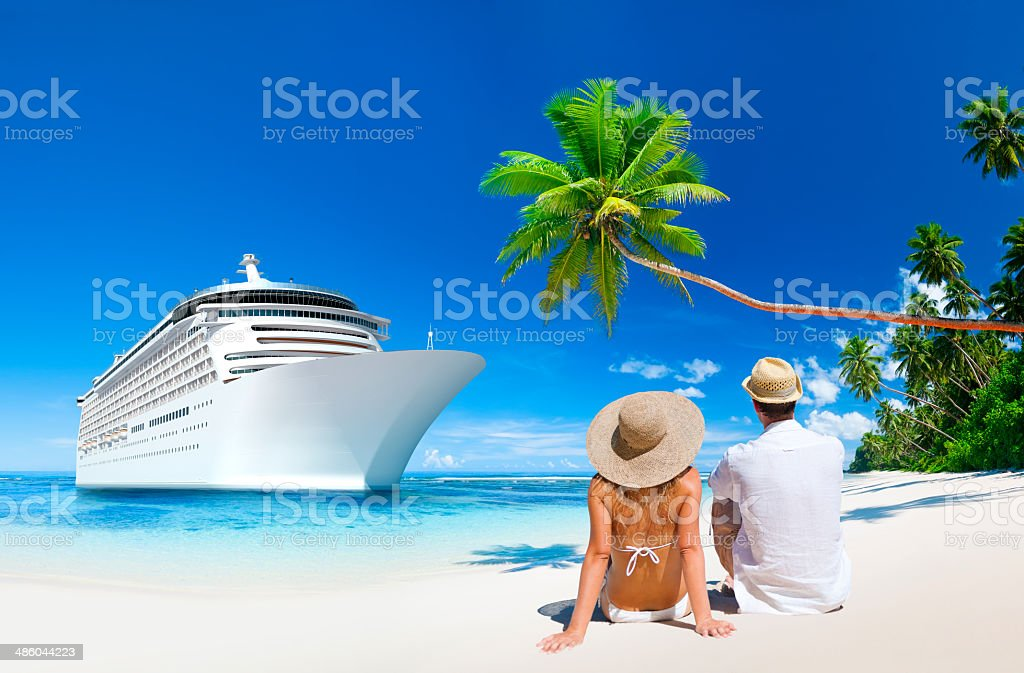 Love Couple sitting at the beach stock photo