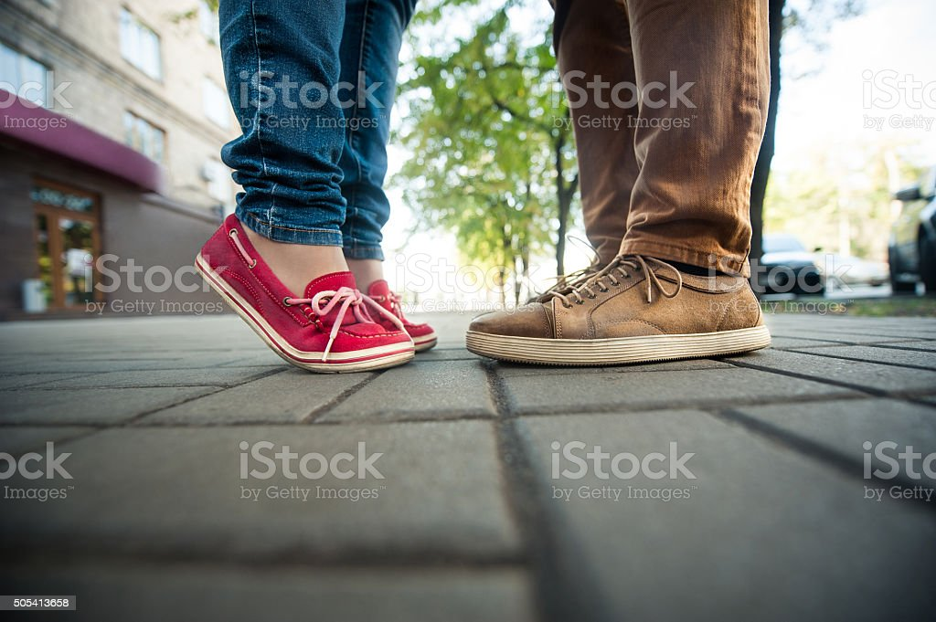 love couple standing on the sidewalk, Legs man and woman stock photo