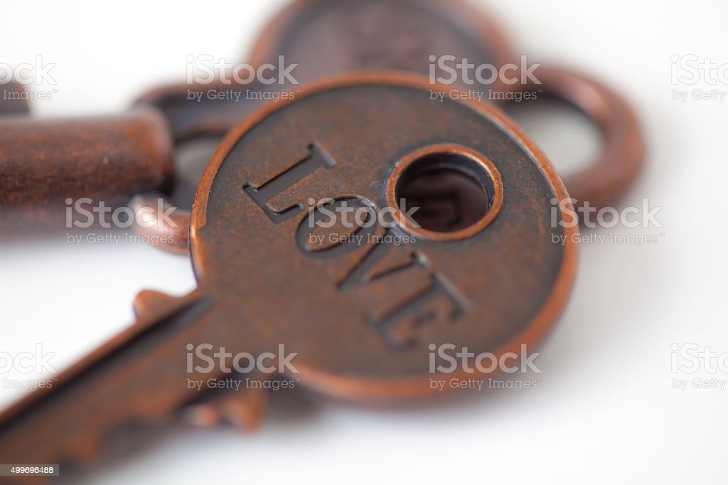 Love engraved on a key stock photo