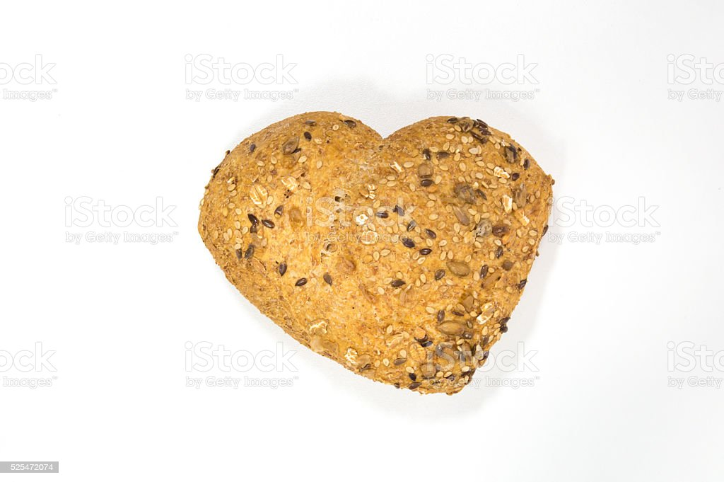 Love for wholemeal bread with seeds on white background stock photo