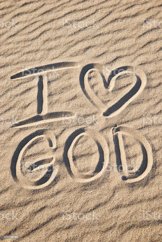 I Love God Message with Heart in Sand royalty-free stock photo
