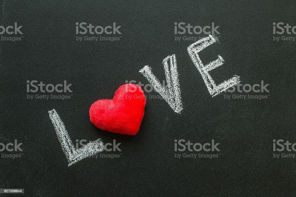 Love Hand writes on the chalk board stock photo
