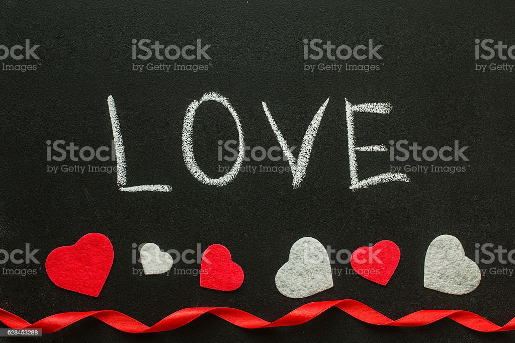 Love Hand writes on the chalk board. stock photo