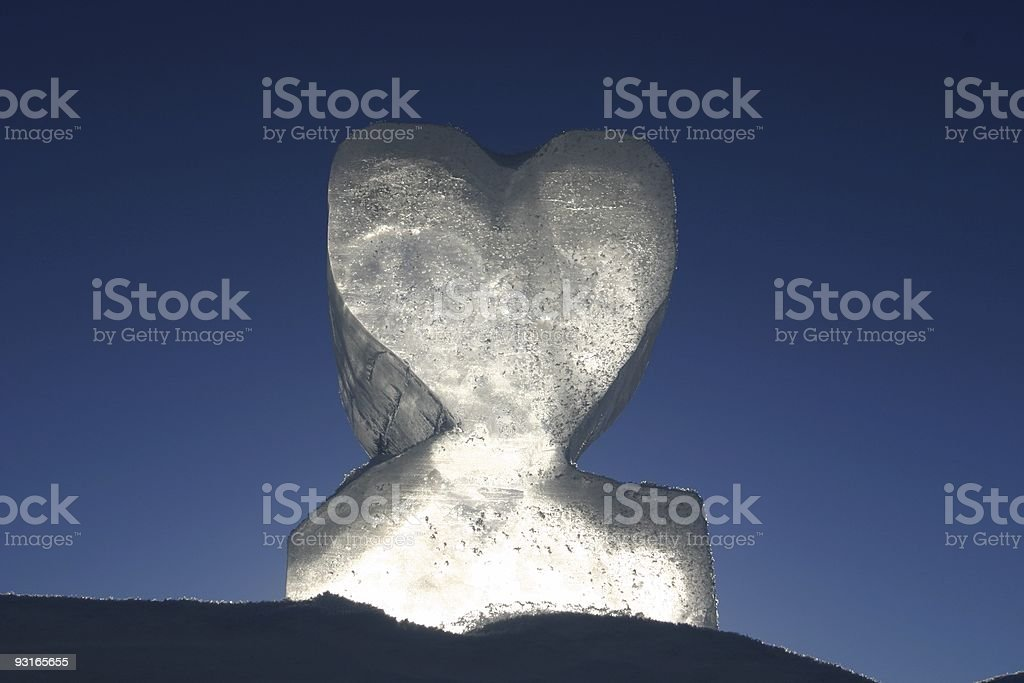 love heart carved in ice against a blue sky stock photo