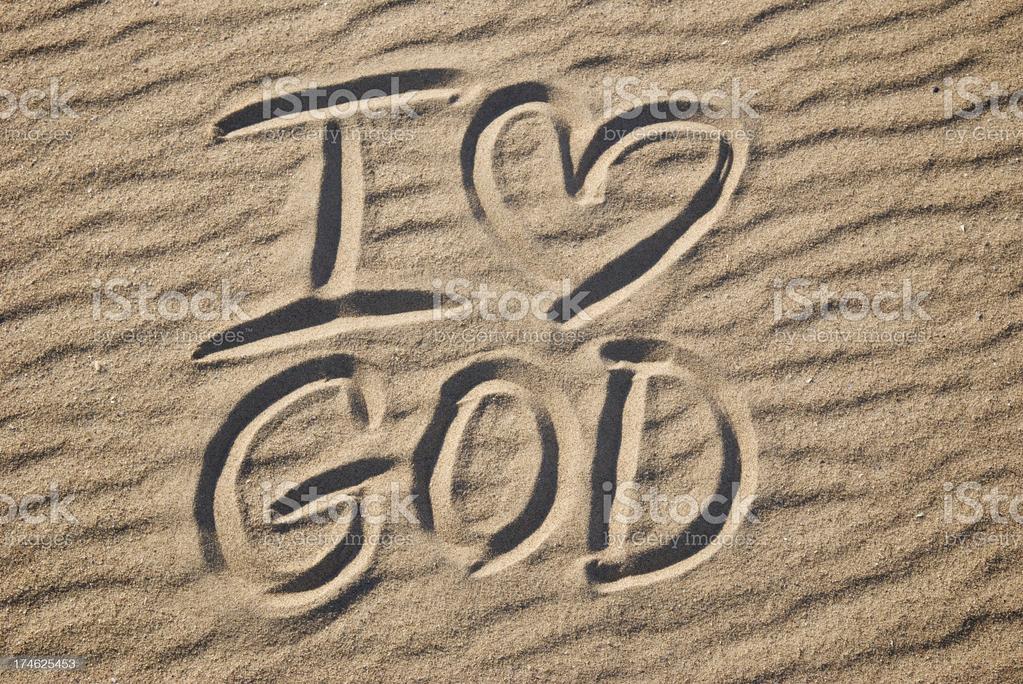 I Love Heart God Message in Textured Sand royalty-free stock photo