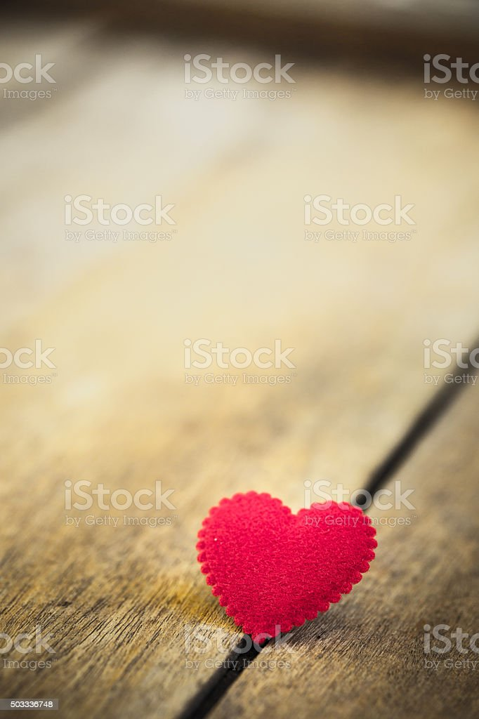 Love heart on wooden texture background, valentines day stock photo