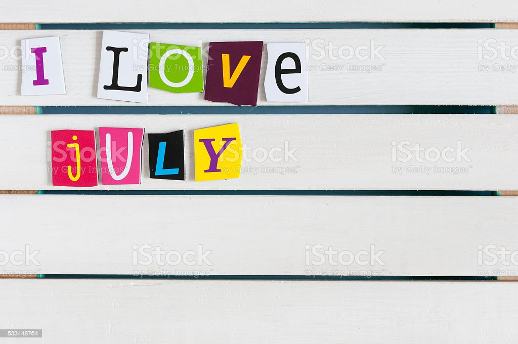 I Love July written with color magazine letter clippings on stock photo