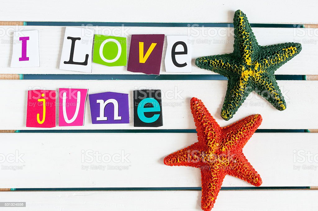 I Love June written with color magazine letter clippings on stock photo
