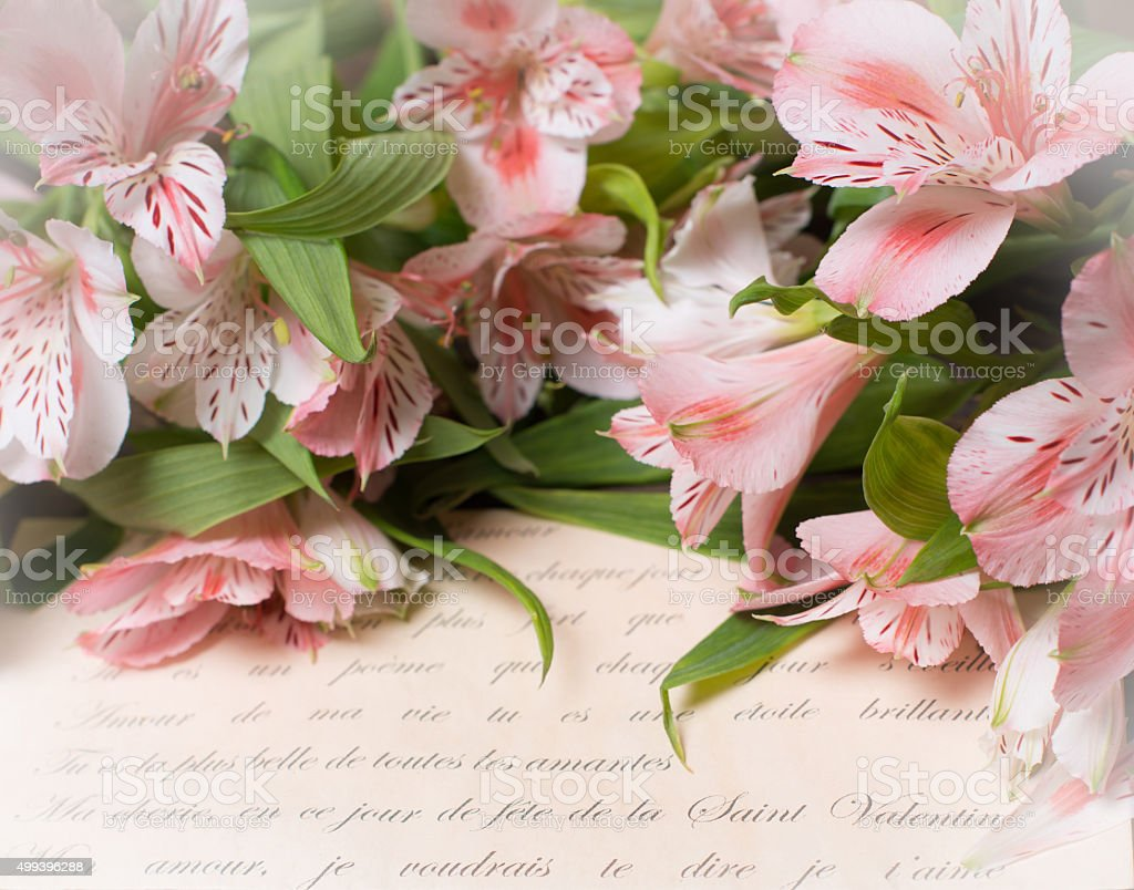 Love letter and flowers. Vintage retro Valentine's day background. stock photo