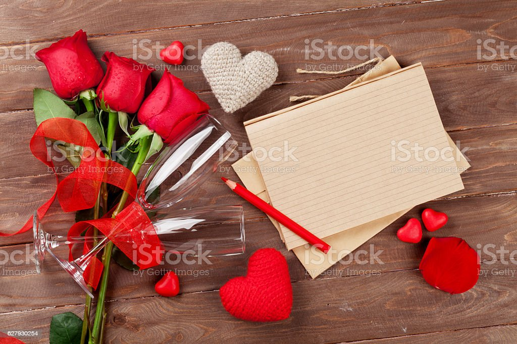 Love letter notepad, red roses and hearts stock photo