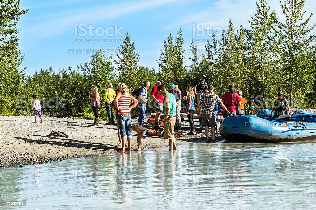 Love Local:  Tourists get ready for an Alaskan raft trip royalty-free stock photo