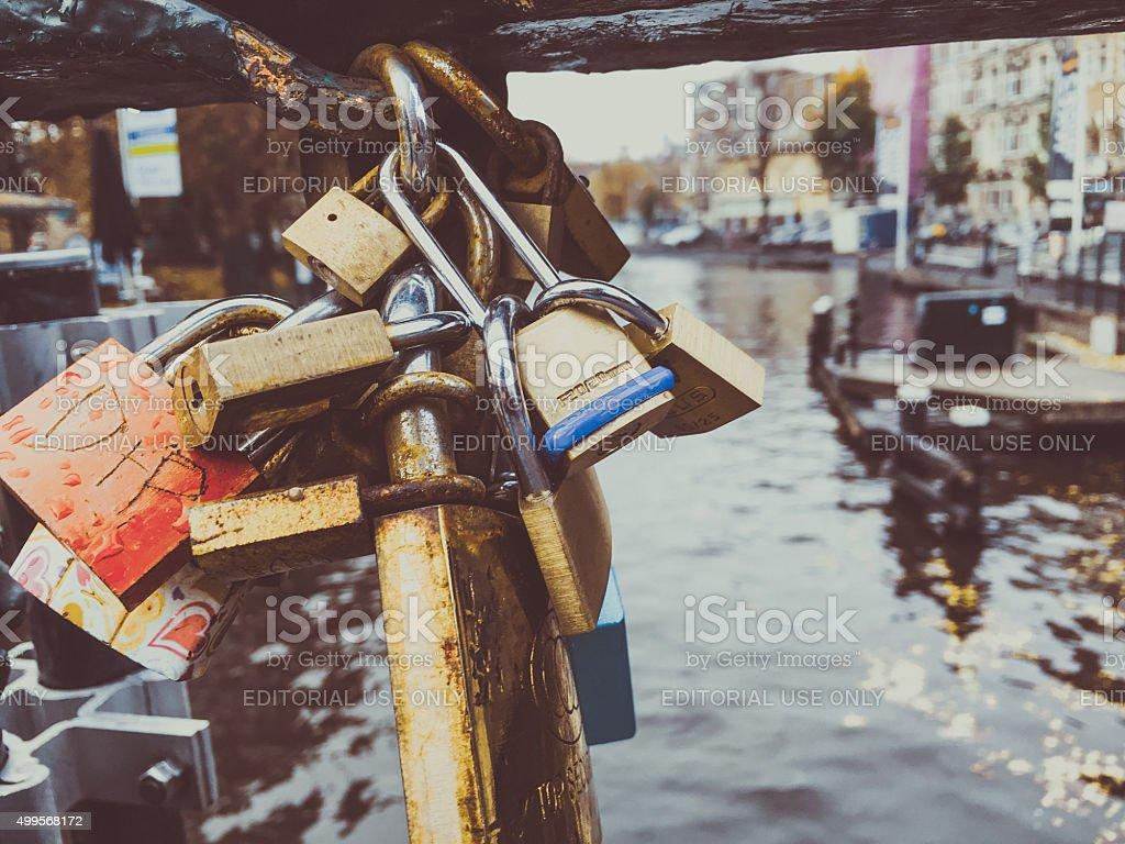 Love Lock or Padlocks from Canal Bridges of Amsterdam stock photo
