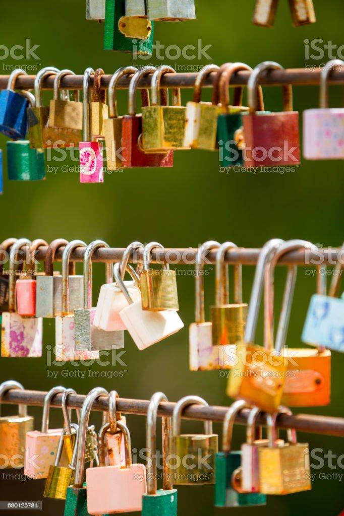 Love locks hang from a bridge stock photo