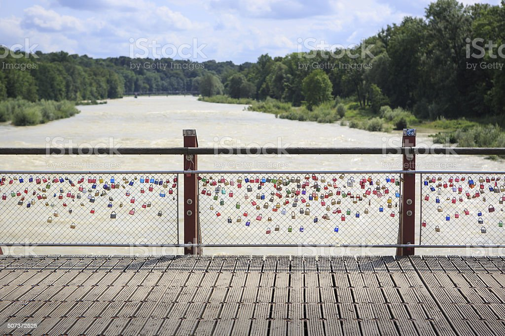 Love Locks on a Bridge over River Isar in Munich stock photo
