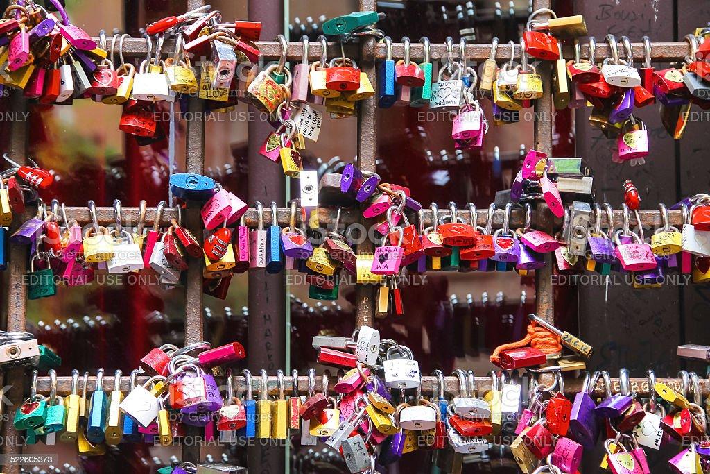 Love locks on  gates of the Juliet house in Verona stock photo