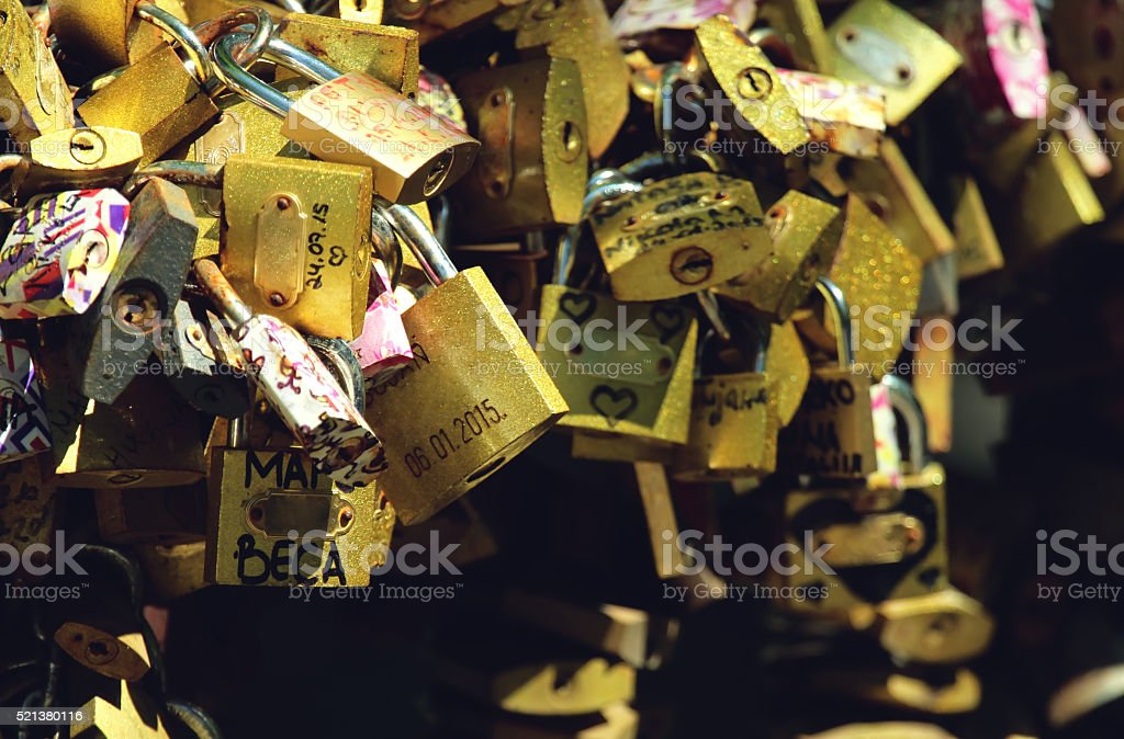 Love locks on the bridge stock photo