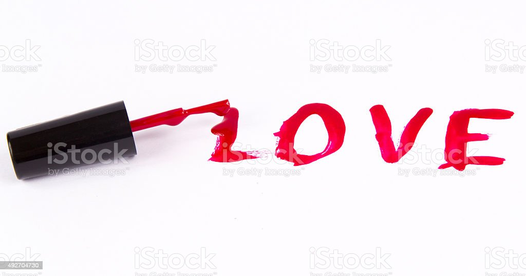 'love' made of nail polish isolated on white stock photo