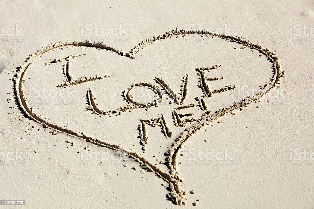 I Love Me Written inside a Heart Drawn in Sand royalty-free stock photo