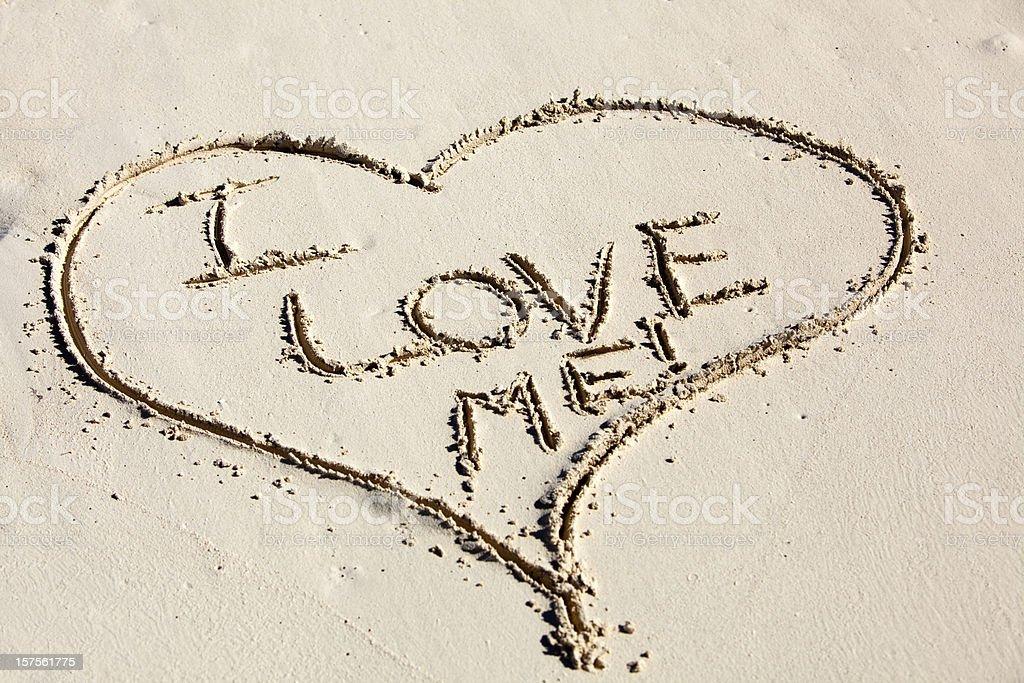 I Love Me Written inside a Heart Drawn in Sand stock photo