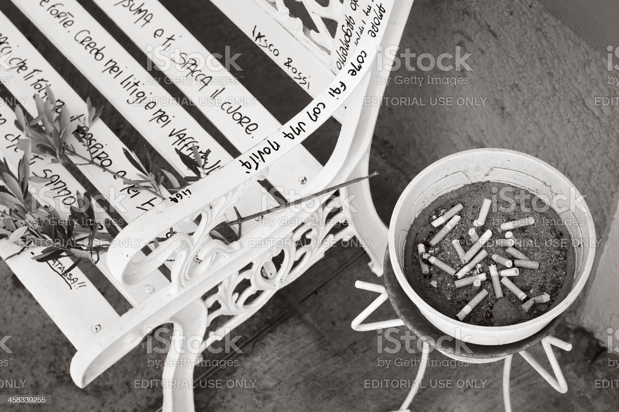 Love messages on a public bench with full ashtray royalty-free stock photo